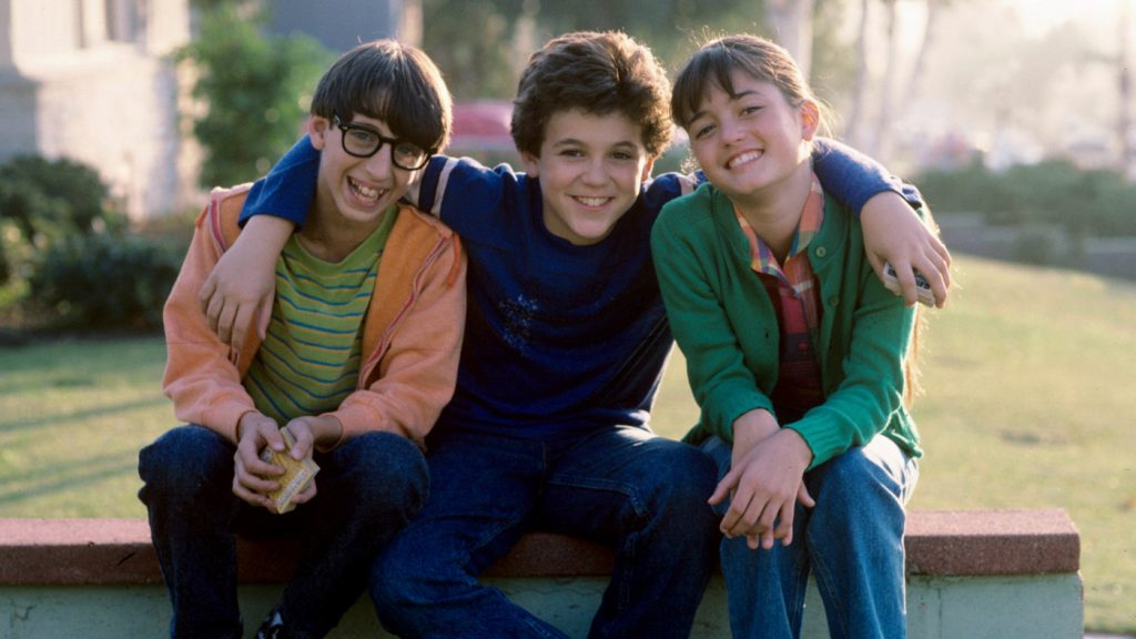 """UNITED STATES - NOVEMBER 30: THE WONDER YEARS - """"The Heart of Darkness"""" - Season Two - 11/30/88, Paul (Josh Saviano, left) and Kevin (Fred Savage) wanted to join the in-crowd with Winnie (Danica McKellar). , (Photo by ABC Photo Archives/ABC via Getty Images)"""