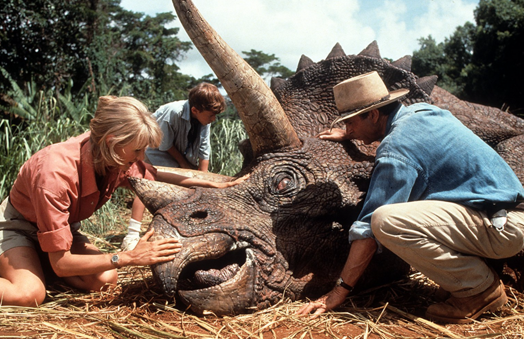 Jurassic Park (1993) Laura Dern and Sam Neill tend to an injured triceratops